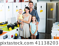 parents with kids in store 41138203