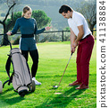 Male golfer female 41138884