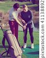 Male golfer female 41138892