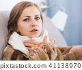 Sick girl with scarf on neck 41138970