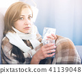 Sick girl on sofa taking drugs 41139048