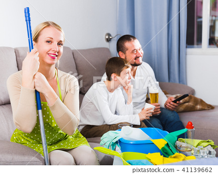 Smiling woman dressed for cleaning 41139662