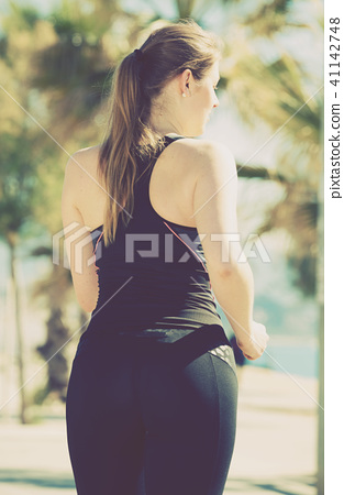 Woman jogging during outdoor workout 41142748