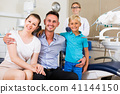 Visitors are on dentist's receptionist 41144150