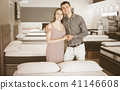 Family couple in furniture store 41146608