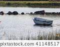 Lone row boat by the coast 41148517