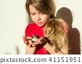 Girl child 7 years old her beloved pet - hamster. 41151951