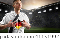 Germany soccer or football supporter showing flag 41151992