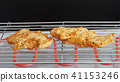 marinated chicken on electric table grill 41153246