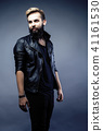 portrait of young bearded hipster guy on gray dark background cl 41161530