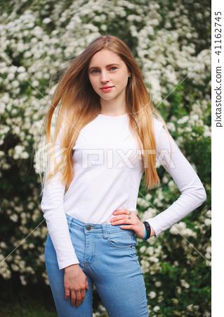 beautiful blonde girl on the street 41162745
