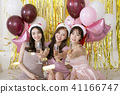 x-mas, new year party concept photo. holding balloons, happy friends having fun together. 068 41166747