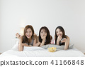 friendship, pajama party and make-up concept, happy friends having fun together. 107 41166848