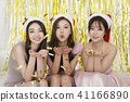 x-mas, new year party concept photo. holding balloons, happy friends having fun together. 073 41166890