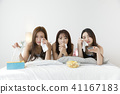 friendship, pajama party and make-up concept, happy friends having fun together. 114 41167183