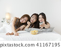 friendship, pajama party and make-up concept, happy friends having fun together. 108 41167195