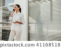 Businesswoman enjoying pleasant dialog by cellphone 41168518