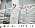 Elegant woman enjoying smartphone communication 41168533
