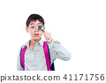 boy looking thru magnifying glass over white  41171756