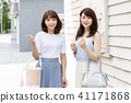 年轻的女士旅行购物 41171868