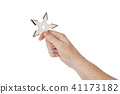 Hand is throwing ninja shuriken 41173182