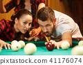 Close-up shot of a man playing billiard 41176074