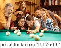 Close-up shot of a man playing billiard 41176092
