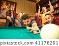 Close-up shot of a man playing billiard 41176291