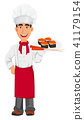 Young professional chef in uniform and cook hat 41179154