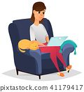 Woman at home sitting in comfortable armchair 41179417