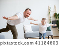 Photo of young father with son playing in plane 41184603