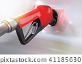 red gasoline dispenser refueling to a white car 41185630