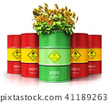 Biofuel drum with sunflowers in front of oil 41189263