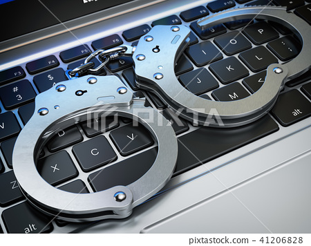 Handcuffs on the laptop keyboard. Internet  crime 41206828