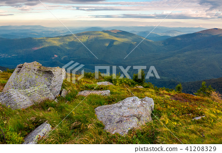 boulders on the edge of hillside 41208329