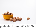 Yellow bowl full of walnuts isolated 41210768
