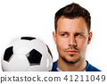 Close-up portrait of young handsome football player soccer posing on white isolated. 41211049
