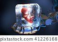 fetus frozen into ice cube held by robotic arm 41226168