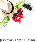 Flat lay Palm leaves sunglasses photo camera straw 41230683