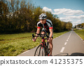 Cyclist in helmet and sportswear, bicycle training 41235375