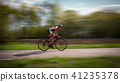 Cyclist rides on bicycle, speed effect, side view 41235378