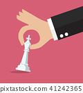 Male hand holding chess figure 41242365