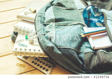 Backpack with school supplies on wooden background 41249716