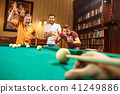 Close-up shot of a man playing billiard 41249886