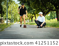 girl learns to skate and the boy gives her advice 41251152