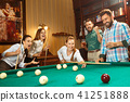 Young men and women playing billiards at office after work. 41251888