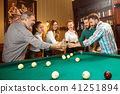 Young men and women playing billiards at office after work. 41251894