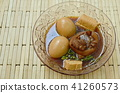 boiled egg with pork leg in herb brown soup  41260573