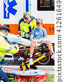 Emergency doctors caring for accident victim boy 41261649