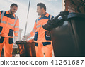 Garbage removal men working for a public utility 41261687